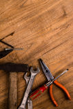 Old tools. On wooden background royalty free stock image
