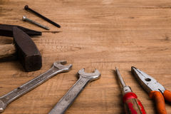Old tools. On wooden background royalty free stock images