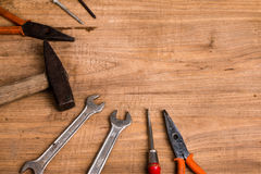 Old tools. On wooden background stock photos
