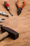Old tools. On wooden background stock photography