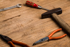 Old tools. On wooden background royalty free stock photos