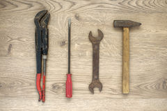 Old tools on wooden background Royalty Free Stock Image