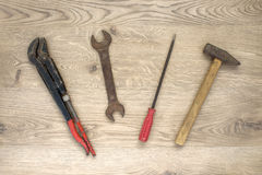 Old tools on wooden background Royalty Free Stock Photo