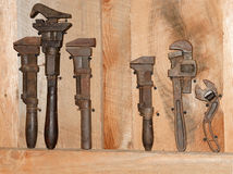 Old tools on a wooden board Stock Photos