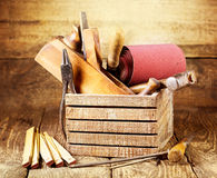 Old tools in a wooden box Royalty Free Stock Images