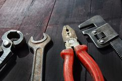 Old tools on a wooden. Background stock image