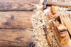 Old tools: wooden planer, hammer, chisel. In a carpentry workshop, top view stock photography