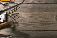 Old tools on a wooden table. With space for your text, top view stock photography