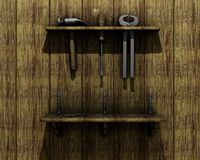 Old tools on wooden wall. A set of old tools hanging from a rack on a wooden wall Royalty Free Stock Photo
