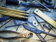 Old tools. Old work tools on a wooden table Royalty Free Stock Photos