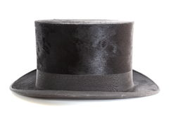 Old topper hat. Old black elegant topper hat over white background stock photo