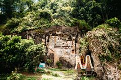 Old torajan burial site in Lemo, Tana Toraja, Sulawesi, Indonesia. The cemetery with coffins placed in caves Royalty Free Stock Images