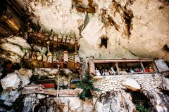 Old torajan burial site in Londa, Tana Toraja, Indonesia. The cemetery with coffins placed in cave Stock Photo