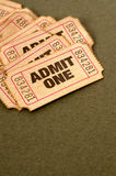 Old torn admit one tickets, several in a pile Royalty Free Stock Image