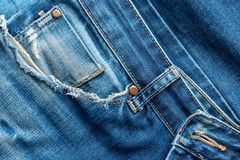 Old torn blue jeans pocket .Texture or background royalty free stock photo