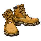 Old torn boots with lacing yellow color Royalty Free Stock Image