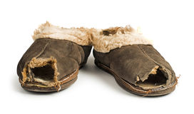 Old torn boots of leather Stock Photos
