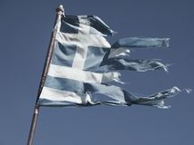 Old and torn flag of Greece Stock Images