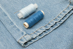 Old torn jeans on a background of burlap. Royalty Free Stock Photography