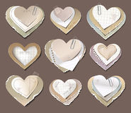 Old torn paper hearts Stock Images