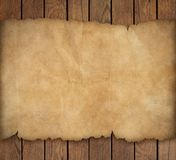 Old torn paper on wooden background Stock Image
