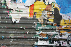 Old torn posters. Torn posters on old wall, signs of graffiti, vandalism and urban decay stock images