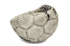 Old torn soccer ball, isolated on white background Royalty Free Stock Photography