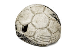 Old torn soccer ball, isolated on white background Stock Photo
