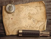 Old torn treasure map with compass and spyglass. Adventure and travel concept. 3d illustration. stock photo