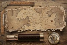 Old torn treasure map with compass and spyglass top view still life. Adventure and travel concept. 3d illustration. Old torn treasure map with compass and stock image