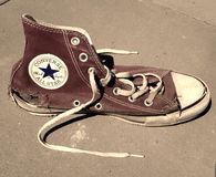 Old torn vintage Converse All Star shoe Stock Images