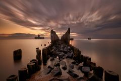 Old torpedo launcher and breakwater landscape, Gdynia stock image