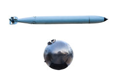 Old Torpedoes and Old Naval bomb on white background. Stock Image