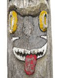 Old totem pole face isolated. Royalty Free Stock Image