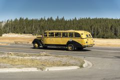Old `Tour Bus` on Continental Divide Trail Old Faithful. Old `Tour Bus` on Continental Divide Trail beside Old Faithful near the famous geyser attraction in stock image