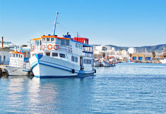 The old tourist vessel in the fishing port. Royalty Free Stock Images
