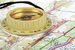Old touristic compass on map Royalty Free Stock Photos