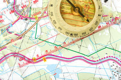 Old touristic compass on map Royalty Free Stock Photo