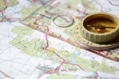 Old touristic compass on map Stock Photos