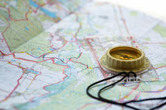 Old touristic compass on map Stock Images
