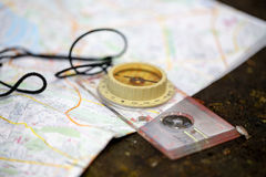Old touristic compass on map Stock Photo
