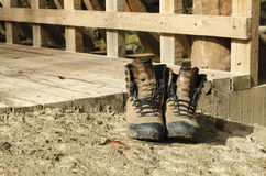Old touristic shoes on a bridge. Selective focus Stock Images