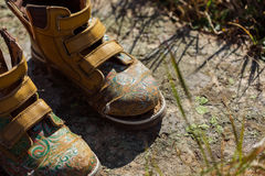 Old tourists boots on stone near mountain stream Stock Photography