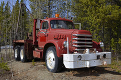 Old tow truck. Old red tow truck parking between trees Stock Image