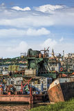 Old Towboats Barges And Dredgers. Historical photograph of Belgrade downtown and Sava river with old, decommissioned, abandoned towboats, barges, cranes and stock image