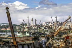 Old Barges On Sava River - Belgrade. Historical photograph of Belgrade downtown and Sava river with old, decommissioned, abandoned towboats, barges, cranes and royalty free stock photo