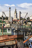 Old Towboats Cranes Barges And Dredgers At Ship Junkyard On Sava River At Savamala - Belgrade - Serbia. Historical photograph of Belgrade downtown with old stock photo
