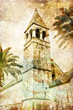 Old tower. Old belfry tower in Croatia - picture in retro style Stock Image