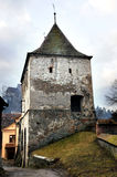 Old tower. An old tower guarding the entrance in the old citadel of Sighisoara, in Transylvania. The only citadel still inhabitated Royalty Free Stock Photography
