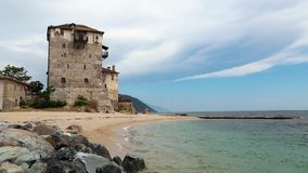 Old tower at the beach in Ouranoupoli, Athos peninsula, Chalkidiki, Greece Royalty Free Stock Image